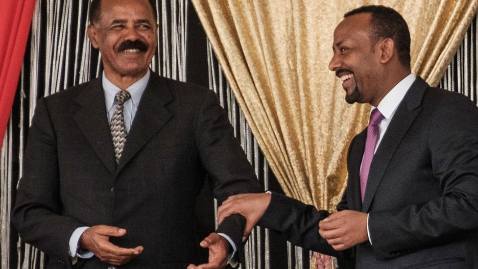Some believe Eritrea's President Isaias (L) may have been involved in the planning of the Tigray invasion with Mr Abiy (R)/AFP